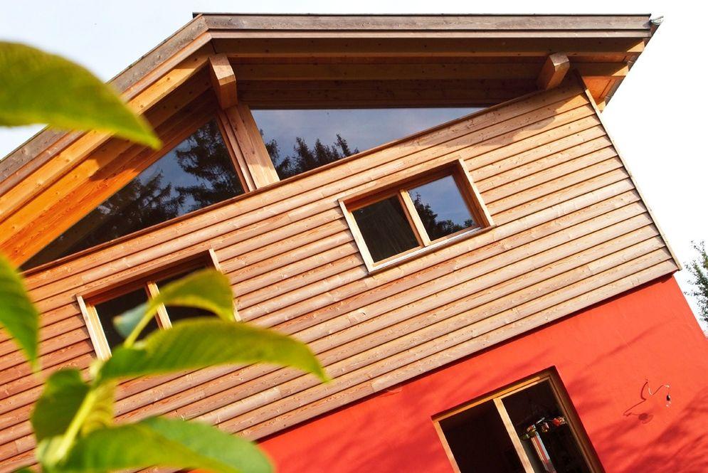 Ansicht Holzfassade Obergeschoss © Brunthaler Massivholzhaus