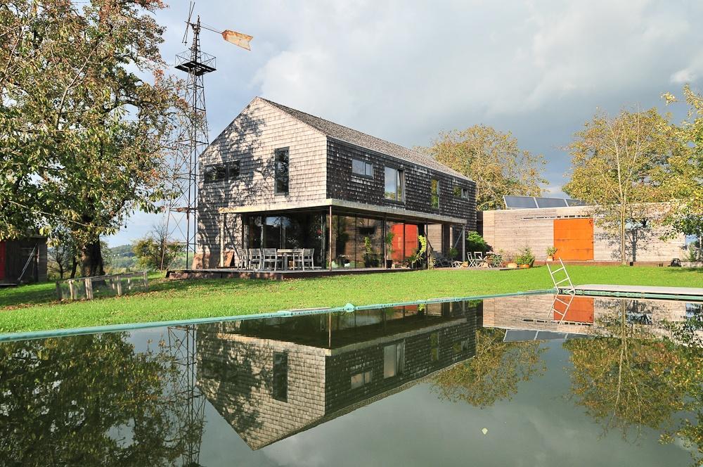 Massivholzhaus mit Garten und Swimmingpool © Brunthaler Massivholzhaus