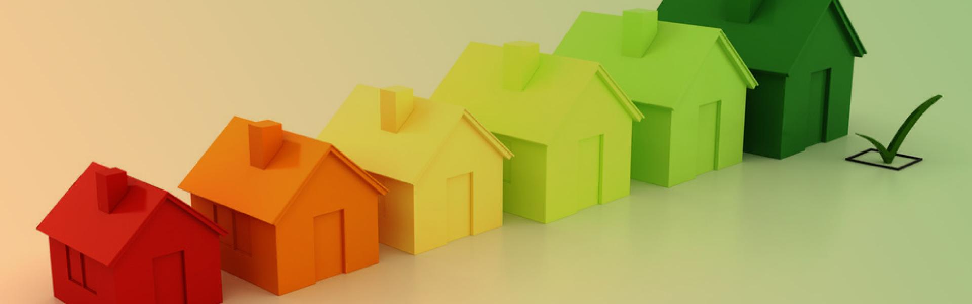 Illustration zum Thema Energieeffizienz. Häuser in verschiedenen Farben.